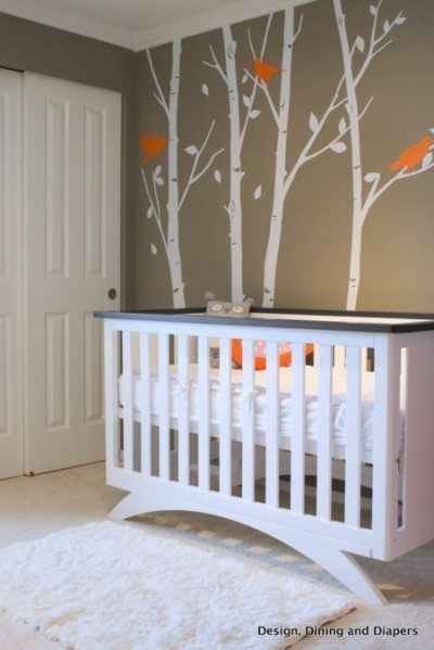 modern nursery, orange accents, orange and gray, bird themed nursery, white nursery furniture, trees