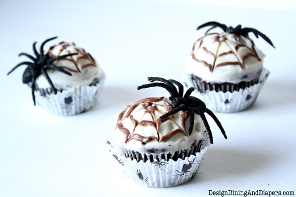 Chocolate Spiderweb Cupcakes!! A delicious and spooky treat! Moist cupcakes with a cream cheese frosting and a swirl of chocolate cream cheese frosting!!