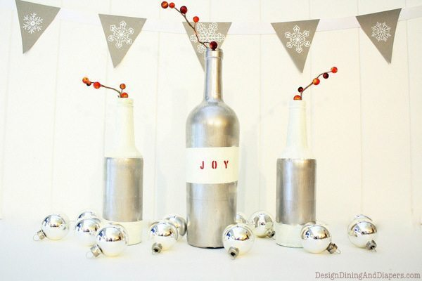 DIY Christmas Bottle Decor and Bunting by Design, Dining + Diapers, Painted bottles, silver bottles, recycled wine bottles, christmas bunting, snowflake decor, gray and white, red and gray christmas, silver christmas decor, handmade holiday ideas
