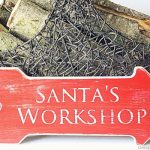 Distressed Santa's Workshop Sign by Design, Dining + Diapers