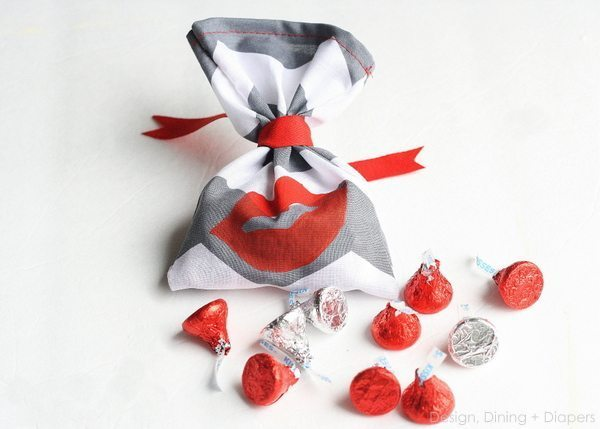 Kiss Me! Handmade Valentine's Day Favors by Design, Dining + Diapers, red and white valentine's day favors, gray polka dot, valentine's bags, red lips, Valentine's Candy Favors
