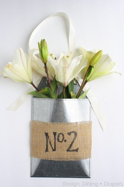 May Day Gift Idea: Front Door Flower Basket Using Fresh Lilies by Design, Dining + Diapers., spring door decor, galvanized baskets, shabby chic flower arrangements, burlap and flowers, door decor