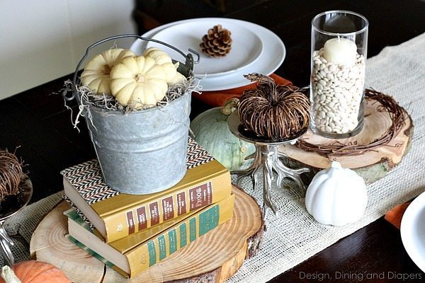 Eclectic Fall Tablescape using books and grapevine pumpkins