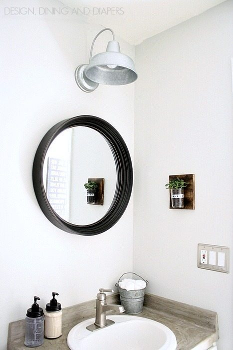 Modern Farmhouse Half Bath Makeover! You have to see the before and after. via designdininganddiapers.com
