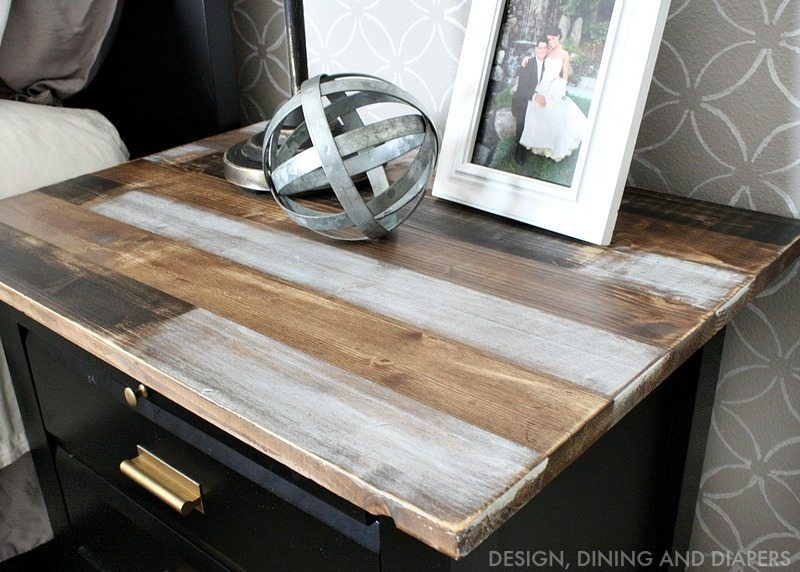 Faux reclaimed wood table top using ScotchBlue Painter's tape and different stains!