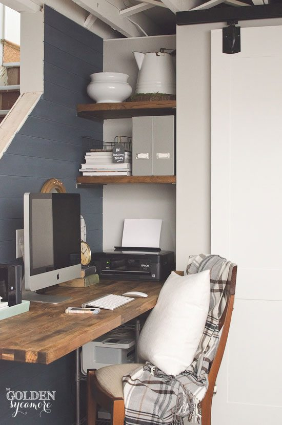 small-office-nook-tucked-next-to-stairs-with-butcher-block-desk-and-plank-wall