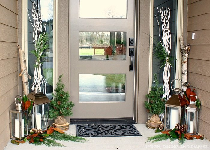 Holiday porch with magnolia leaves and greenery