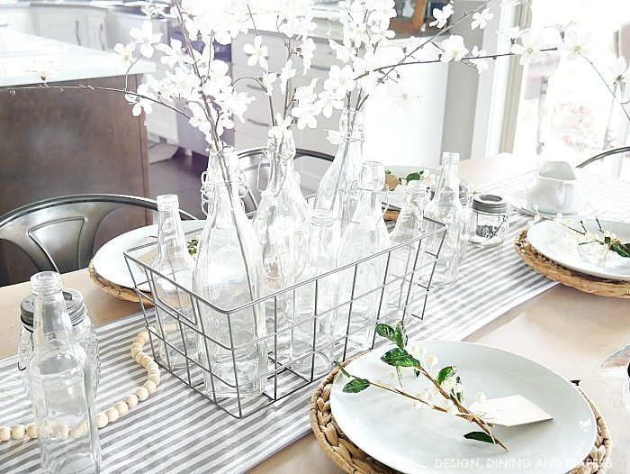 glass bottle centerpiece in basket