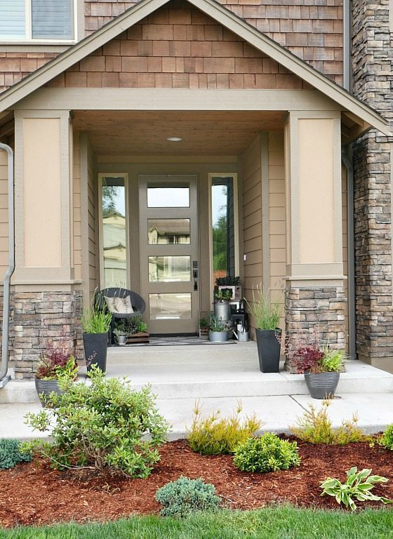Front Entry Way with Lots of Shrubs and Greens