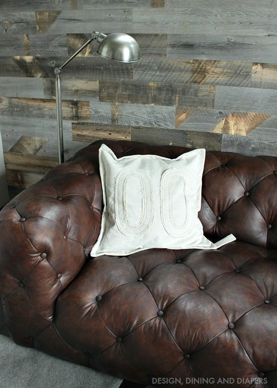 Tufted Brown Leather Sofa with Stikwood reclaimed wall