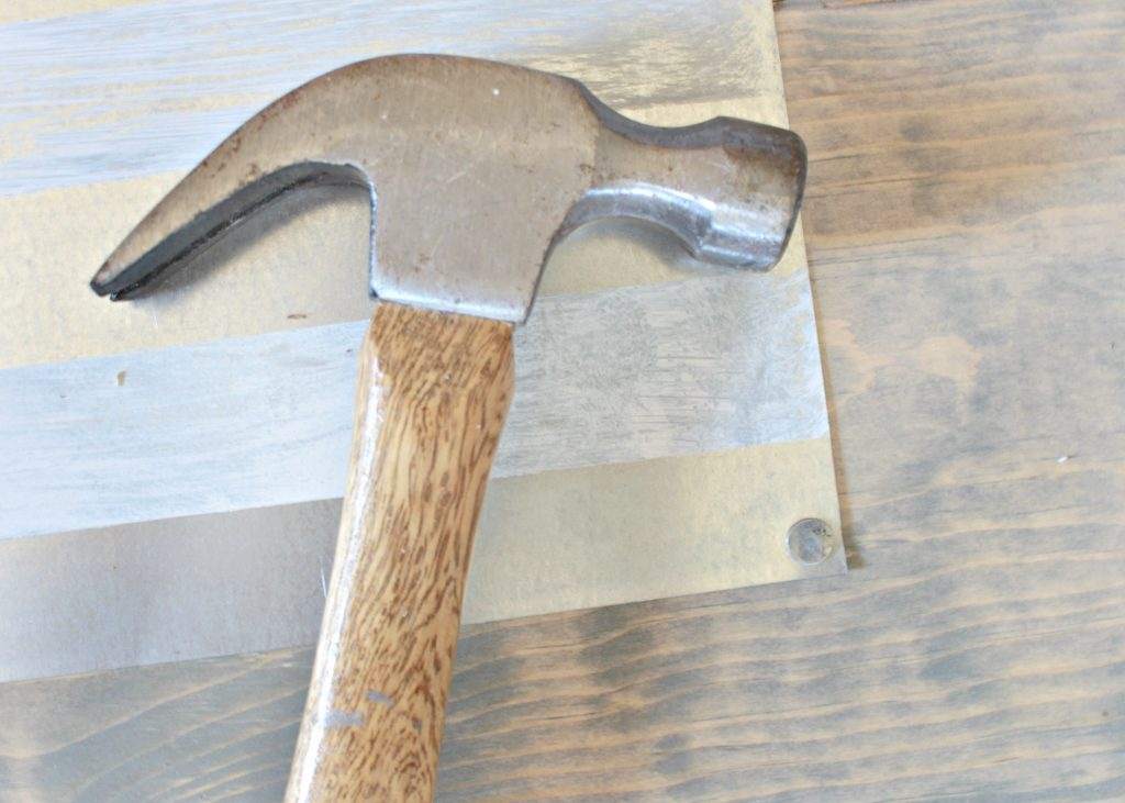Hammering the Metal Onto Wood
