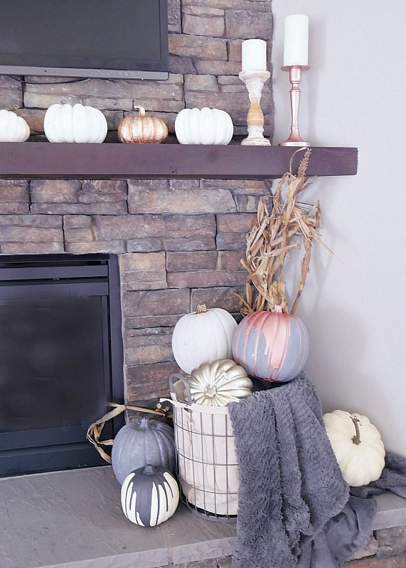 gray-and-metallic-pumpkins-in-basket