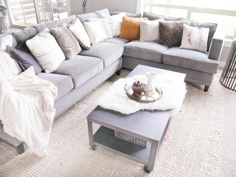 tons-of-cozy-pillows-on-gray-couch