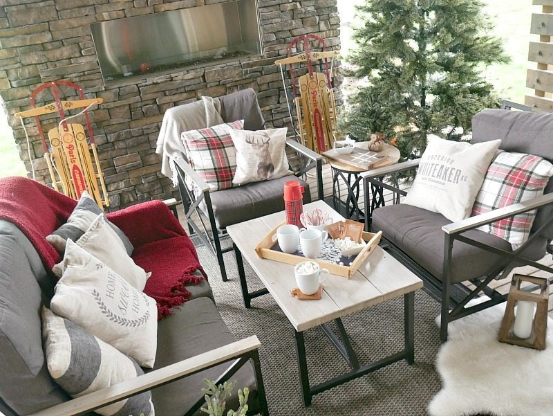 Woodsy Outdoor Christmas Decor with fun pops of plaid! Such a cozy space.