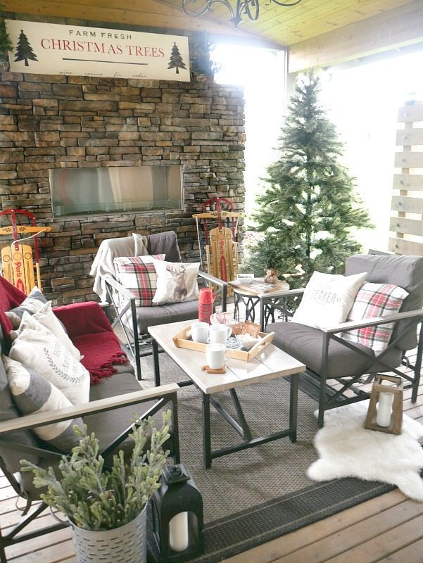 woodsy outdoor christmas decor with fun pops of plaid such a cozy space