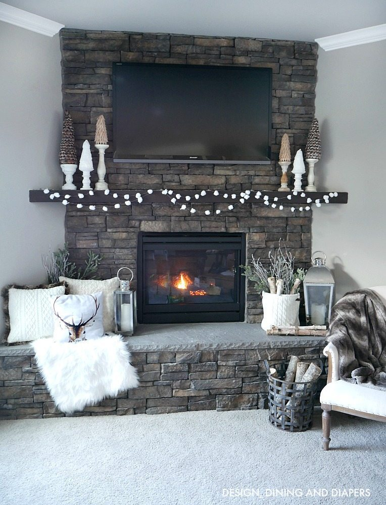 Cozy Winter Mantel - love the soft winter white decor against the stone fireplace.