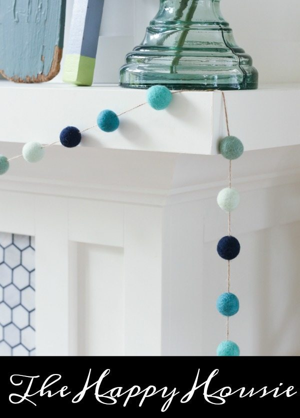 http://thehappyhousie.porch.com/ombre-beachy-diy-felt-ball-garland